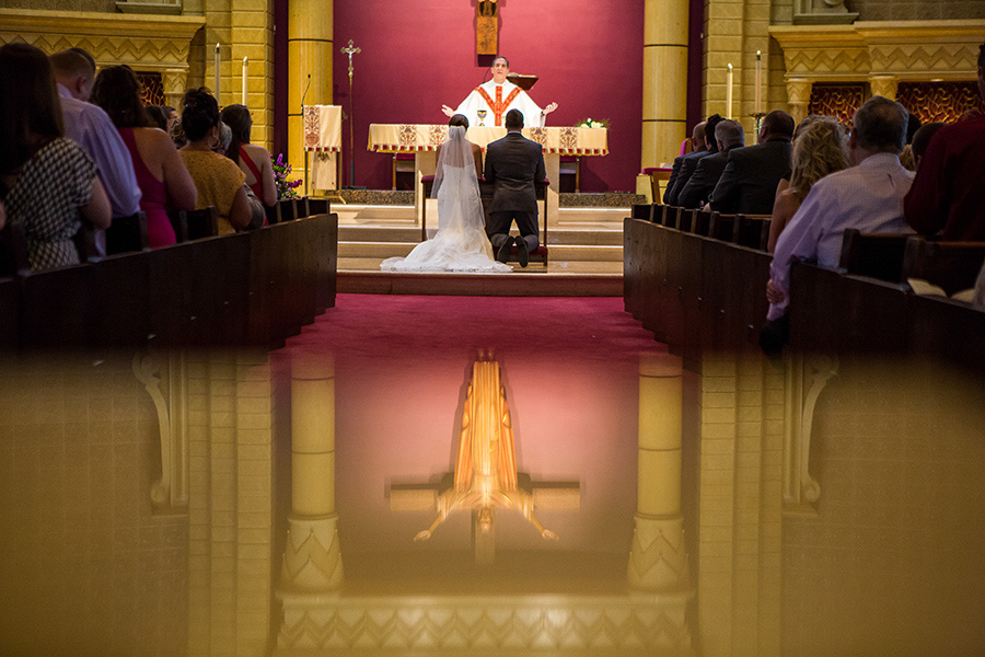 Couple kneeing during mass