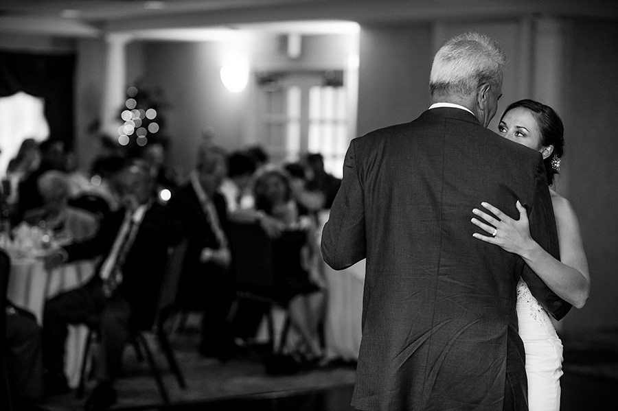 Bride looks at dad during father/daughter dance