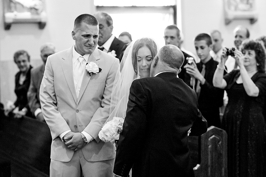 Groom and dad crying as dad gives his daughter away.