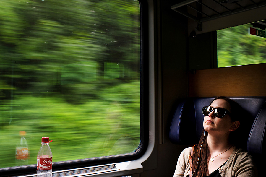 Bride travels on train to her wedding destination.