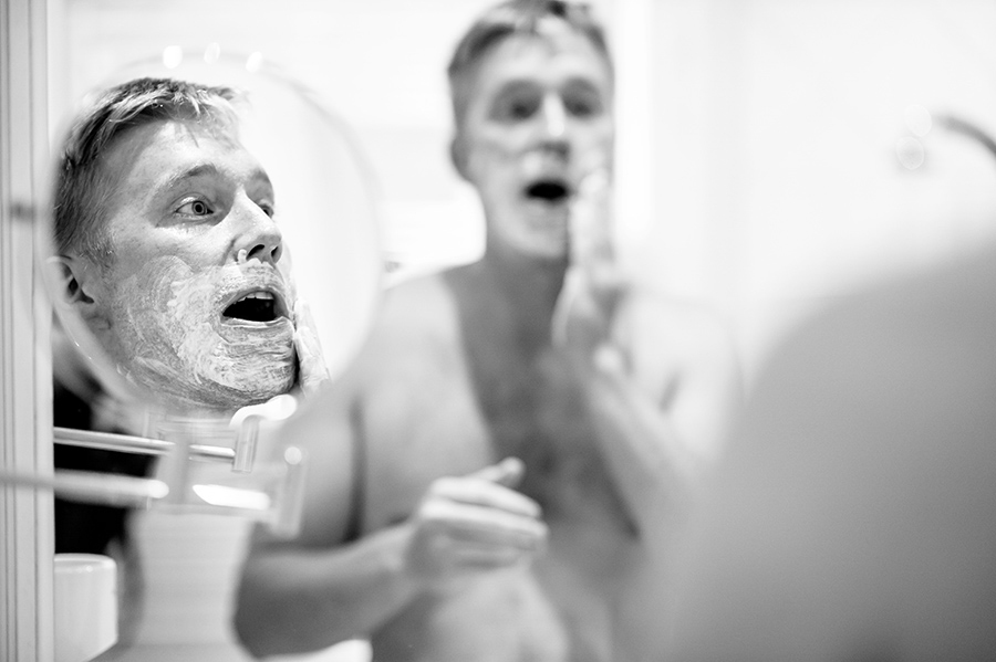 Groom shaves on his wedding morning.