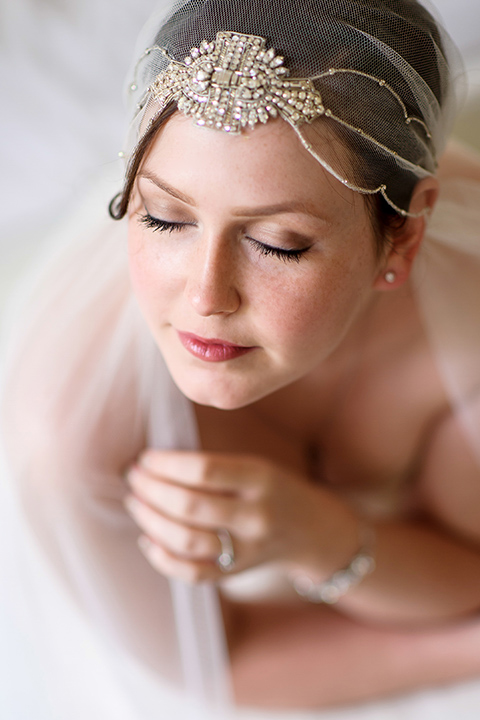 Bride portrait with veiled headpiece on her wedding day.