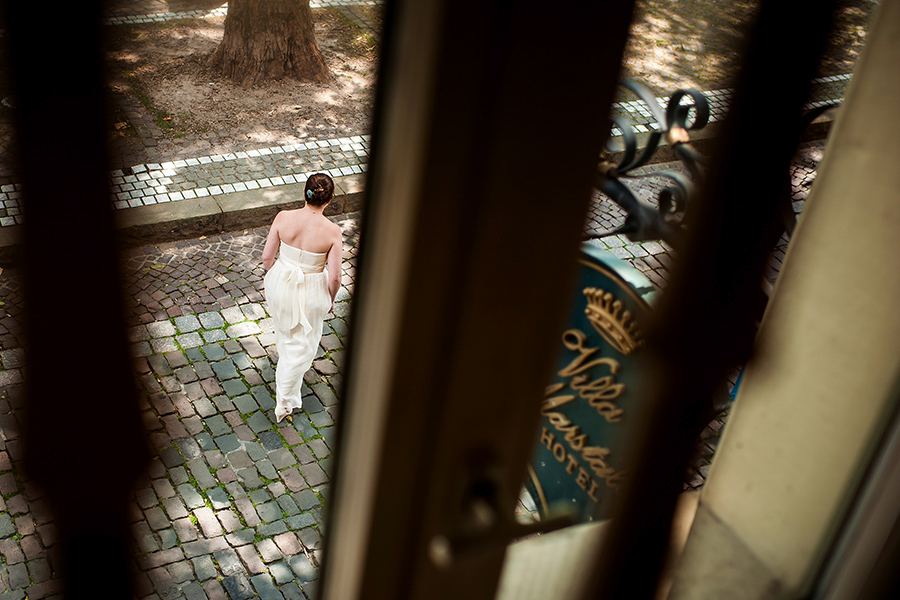 Bride leaves hotel to walk to her wedding ceremony.