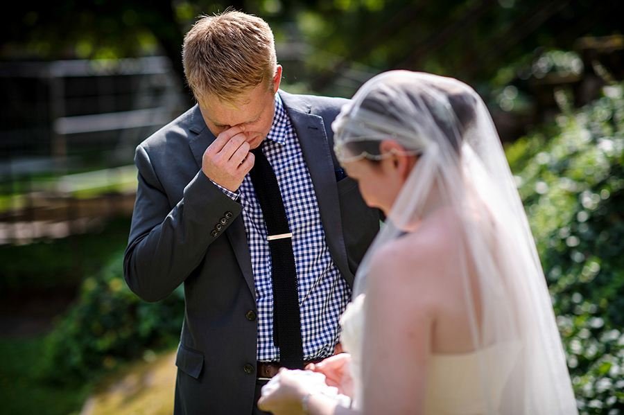 Groom cries during his vows at wedding ceremony.
