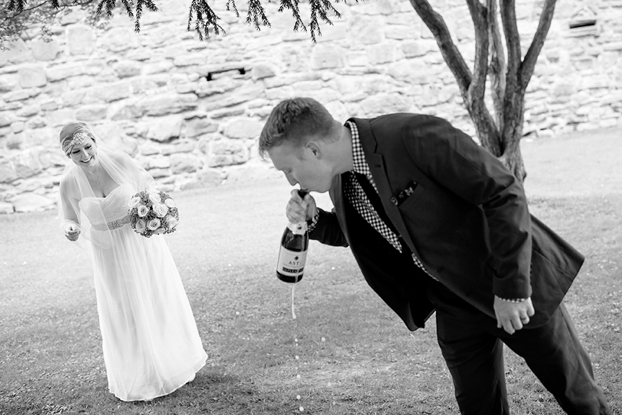 Bride and groom celebrate with champagne after intimate wedding ceremony.