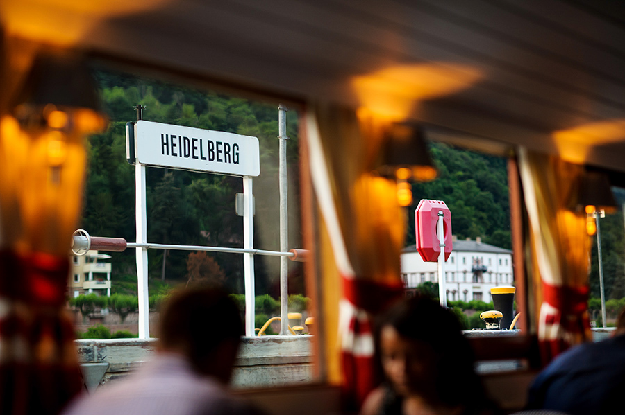 Heidelberg sign visible outside of boat on wedding day.