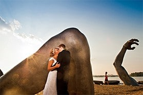 Bride and Groom kissing at the Awakening Sculpture in National Harbor, MD.