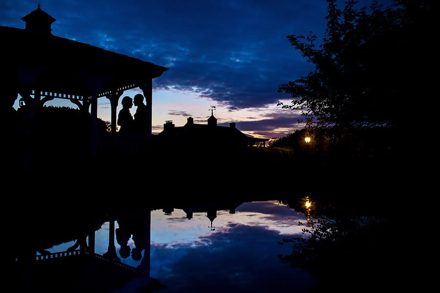 Sunset silhouette of a bride and groom under a gazebo at Antrim 1844 in Taneytown, MD.