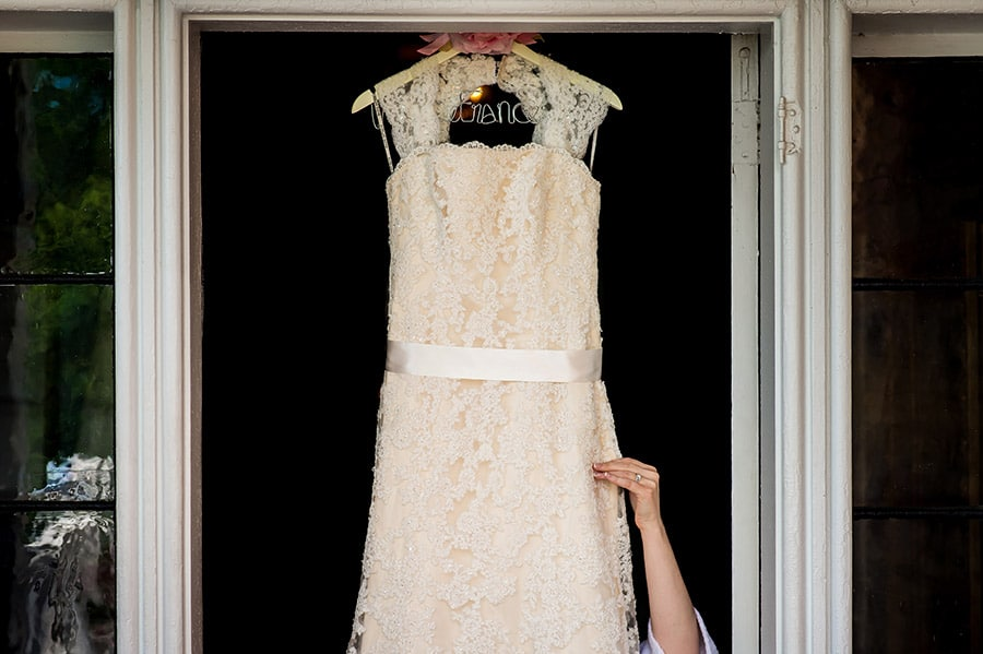 Bride grabbing her wedding dress.