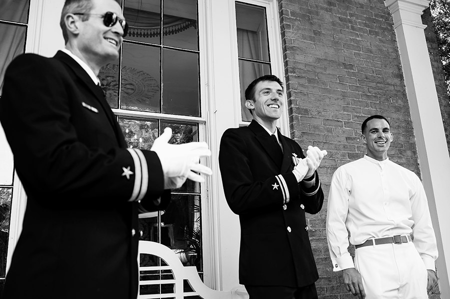 Military groom laughing with his groomsmen.
