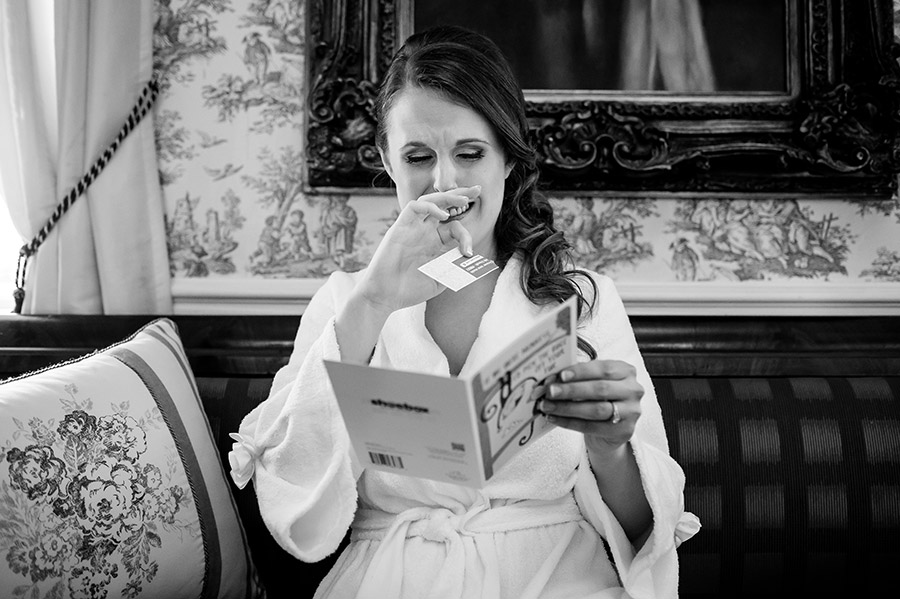 Bride crying as she read card from groom.