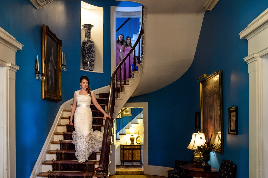 Bride descends staircase at Antrim 1844 in Taneytown, MD.
