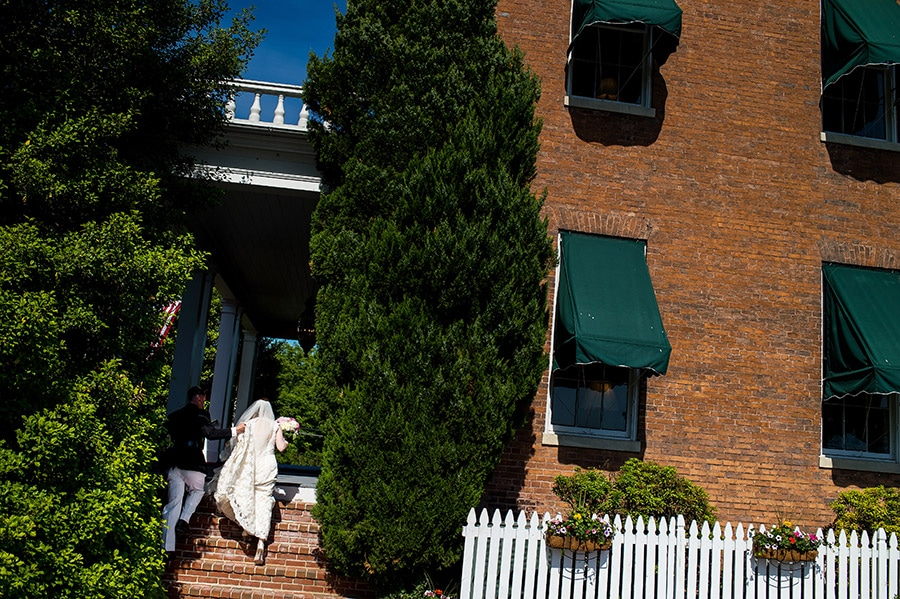Bride and groom walk up stairs into Antrim 1844 in Taneytown, MD.