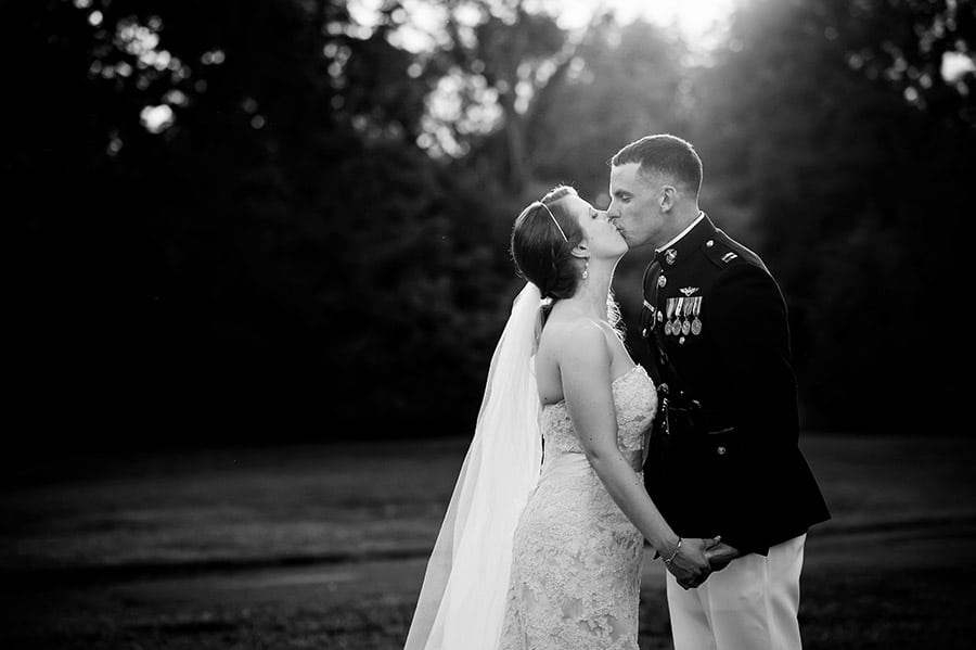 Bride and groom kissing in the evening light.