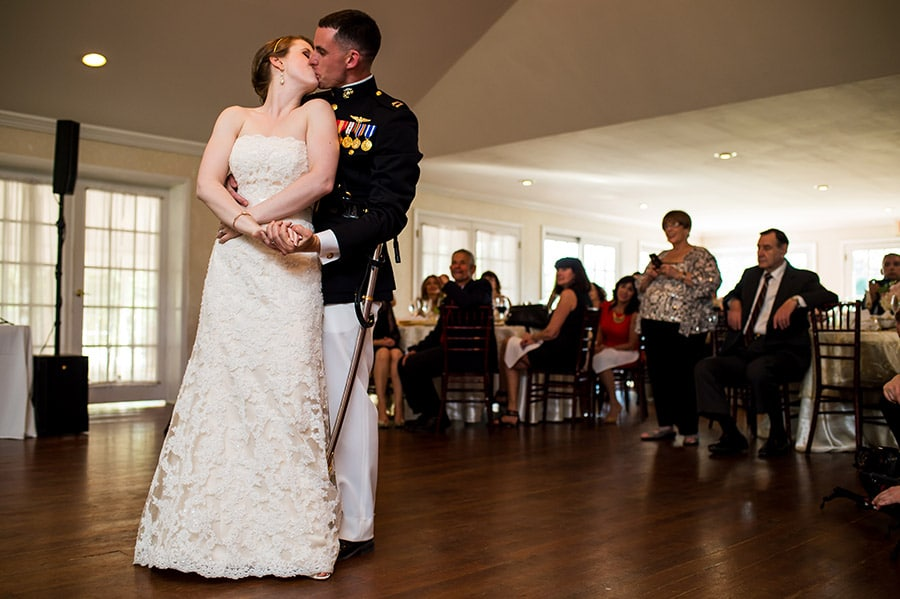 Bride and groom kissing during their first dance on their wedding day.