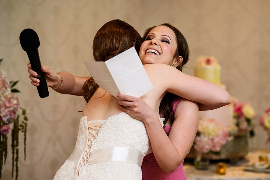 Bride hugging the maid of honor after her speech.