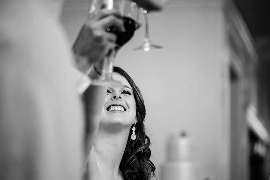 Close up of bride toasting with her wedding guests