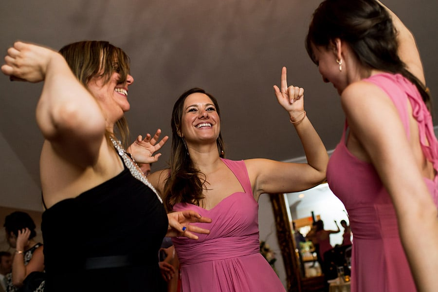 Bridesmaid dances on the dance floor.