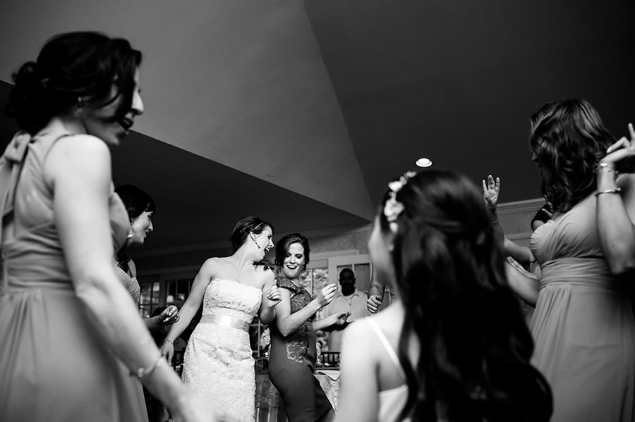 Bride and bridesmaids dance at the wedding reception.