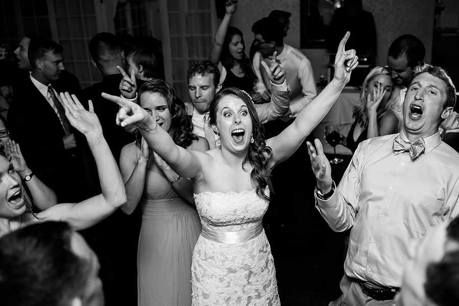 Bride singing and shouting during wedding reception.