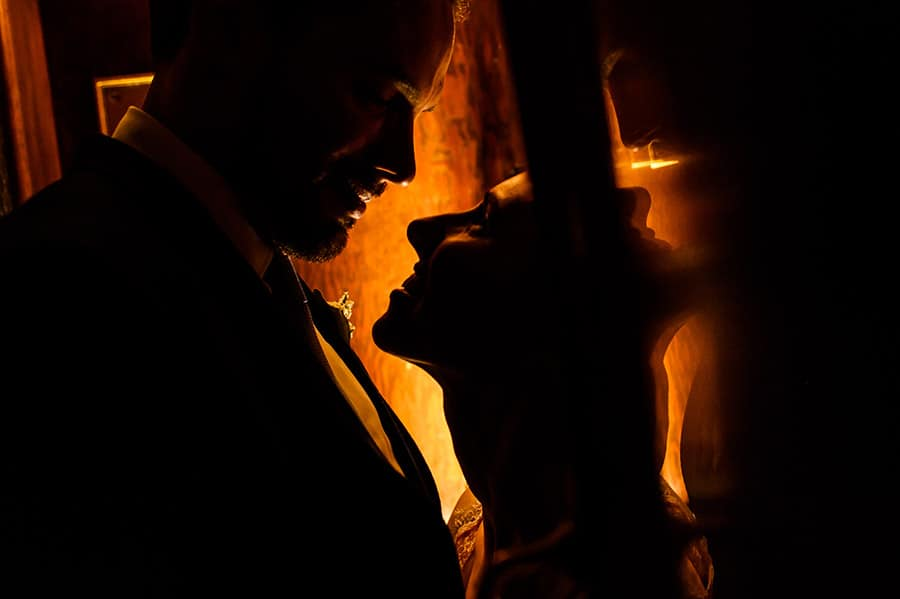 Close up silhouette of a bride and groom on their wedding day.