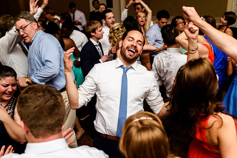 Groom dancing in the middle of all the guests.