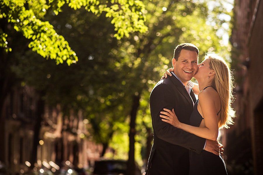 Bride-to-be kissing her groom-to-be on the cheek during their NYC engagement session.
