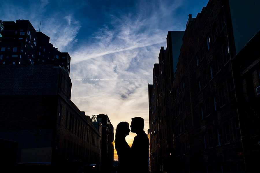 Sunset silhouette of an engaged couple on the NYC Highline.