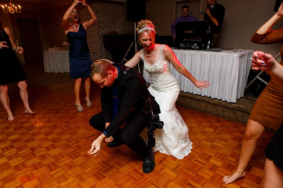 Fun Philadelphia Wedding photographer Dan Moyer and bride dance on her wedding day.