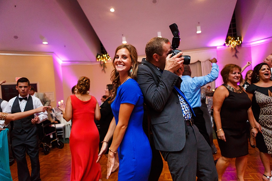 Fun Philadelphia Wedding photographer Dan Moyer and wedding guest dance.