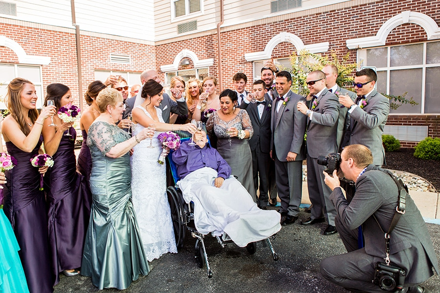 Philadelphia Wedding photographer Dan Moyer capturing a special toast with the brides uncle.