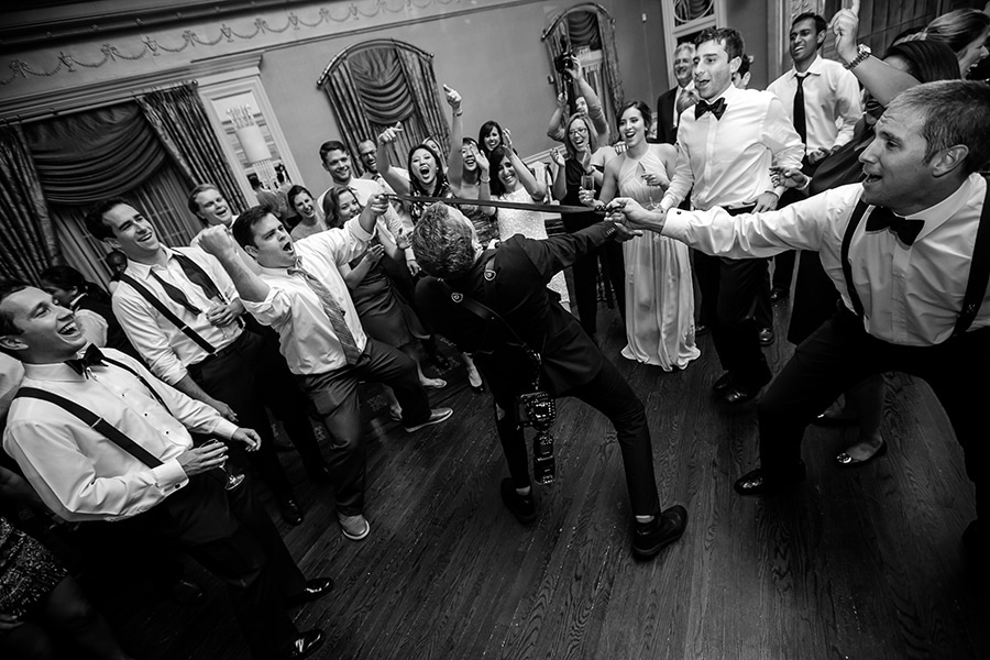 Philadelphia Photographer doing the limbo during wedding day.