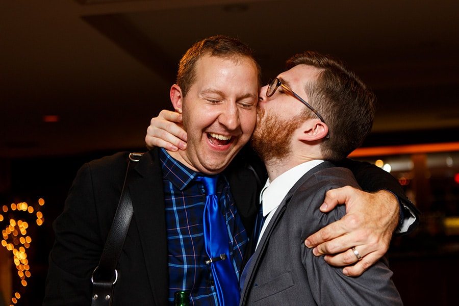 Best man gives photographer kiss on cheek!