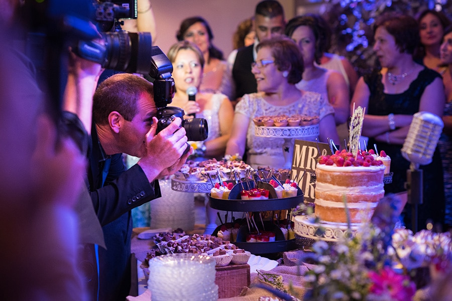 Philadelphia photographer capturing cake cutting during wedding reception.