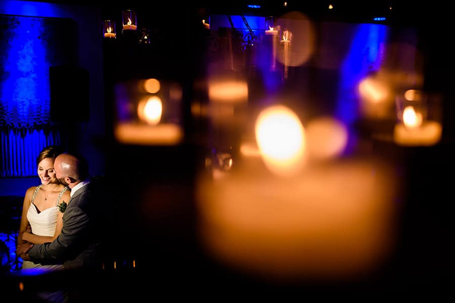 Creative portrait of bride and groom through candles at Artesano Ironworks in Philadelphia