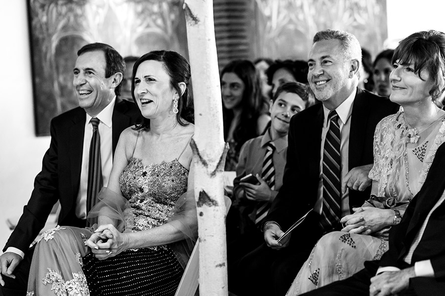 Groom's parents laugh during the wedding ceremony.