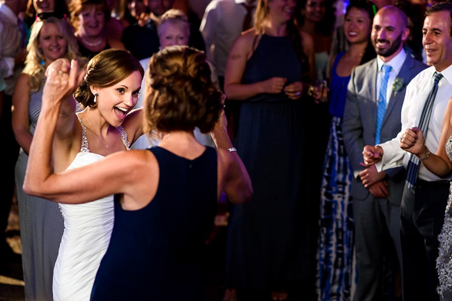 Bride and mom share a special dance on wedding day.