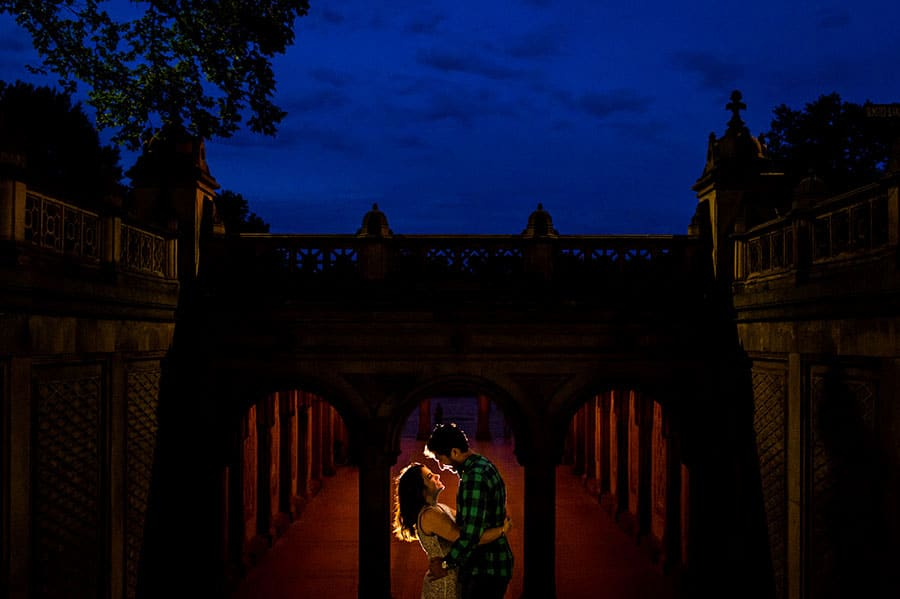 An engaged couple at the Bethesda Fountain during their engagement session.