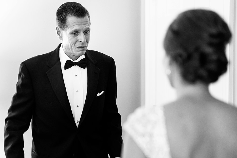 Bride's father sees his daughter for the first time in her wedding dress.