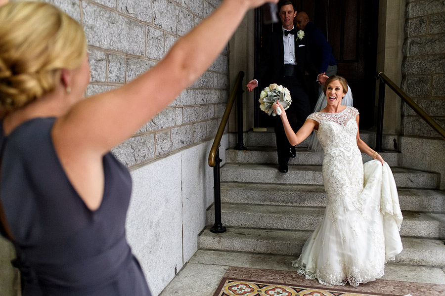 Bridesmaid screams as she sees bride after being married.