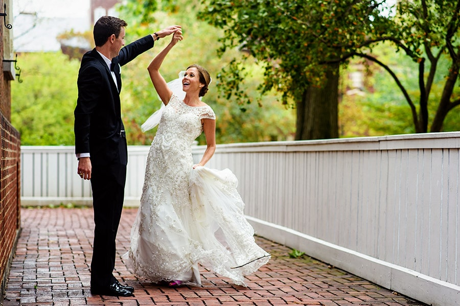 Groom spins bride during wedding portraits.
