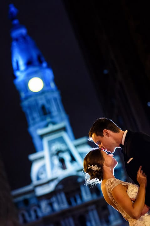Awesome night portrait of Bride and Groom on Broad St. in Philadelphia in front of City Hall.