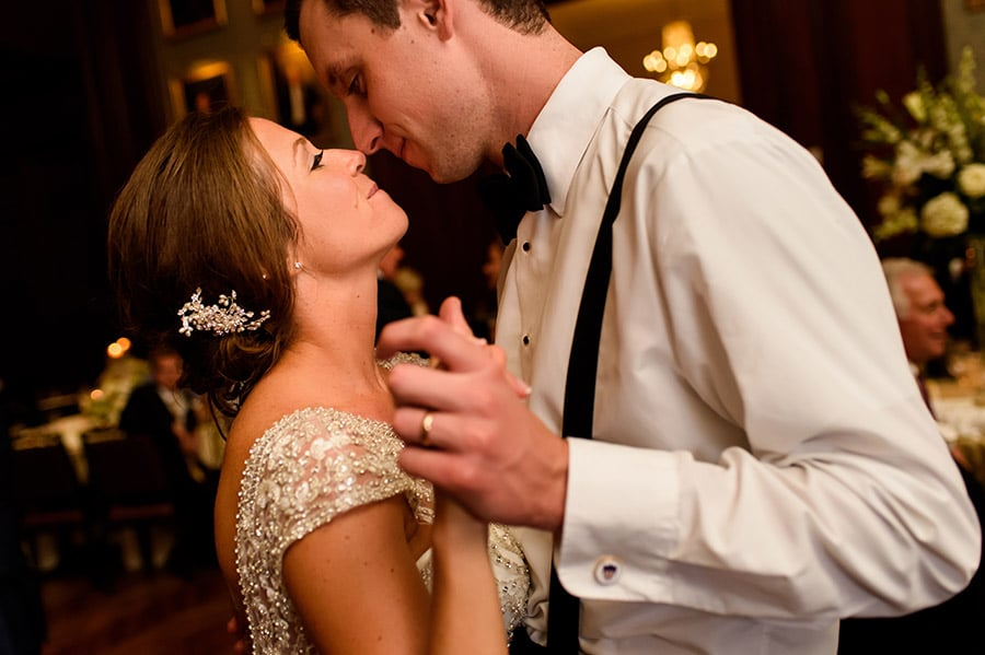 Bride and groom rub noses on the dance floor during wedding reception.