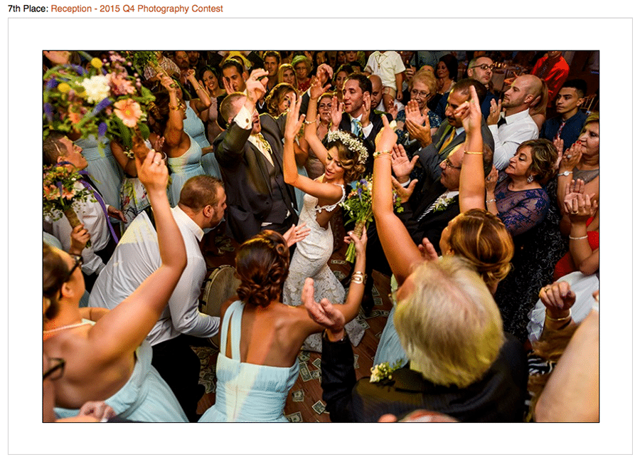 Contest winning photo of bride and groom dancing with wedding guests at Syrian Wedding.