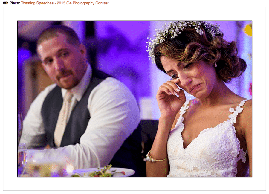Contest winning photo of bride crying at Maid of honor speech during their wedding reception.
