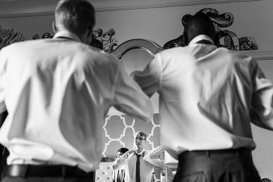 Groom and groomsmen getting ready for wedding at Hotel Monaco in Philadelphia.