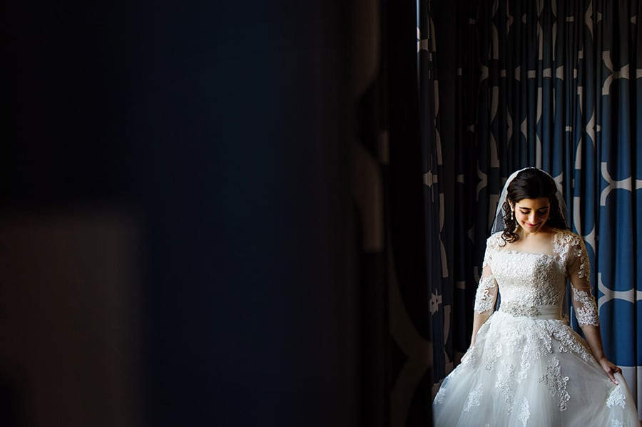 Portrait of a beautiful bride in window light at Hotel Monaco in Philadelphia, PA.