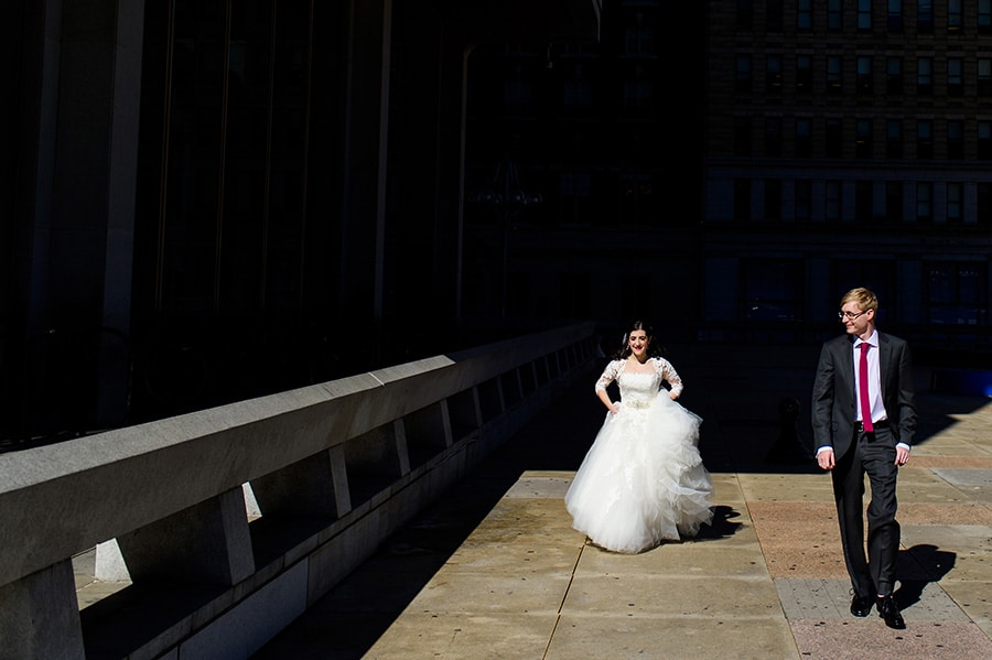 Bride and groom walking in Center City Philadelphia on their wedding day.