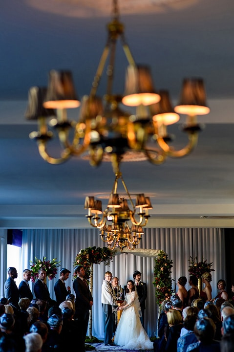 Bride and groom stand under Chuppah during their Jewish wedding ceremony at the Downtown Club in Philadelphia.