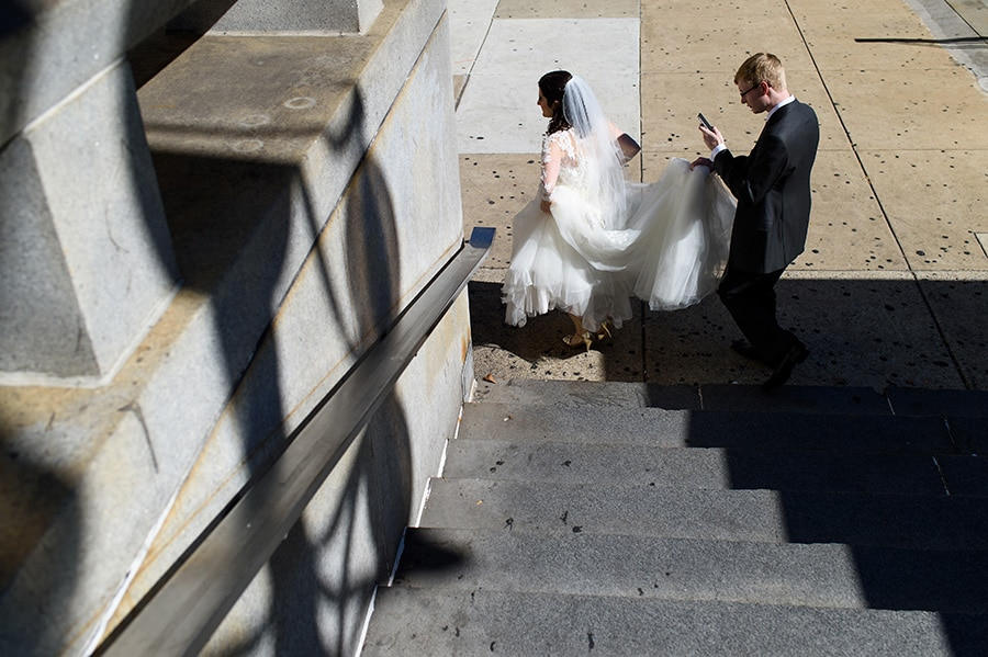 Bride and groom walk in Center City Philadelphia.